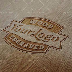 موکاپ لوگوی حک شده روی چوب